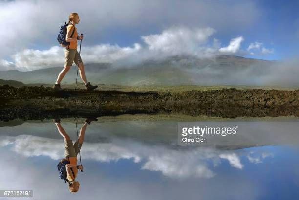 reflection of caucasian girl hiking at river - lake auburn stock photos and pictures