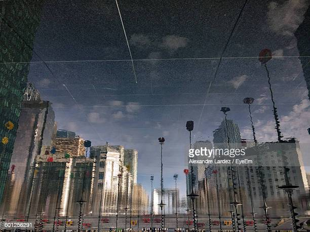 Reflection Of City Buildings On Floor