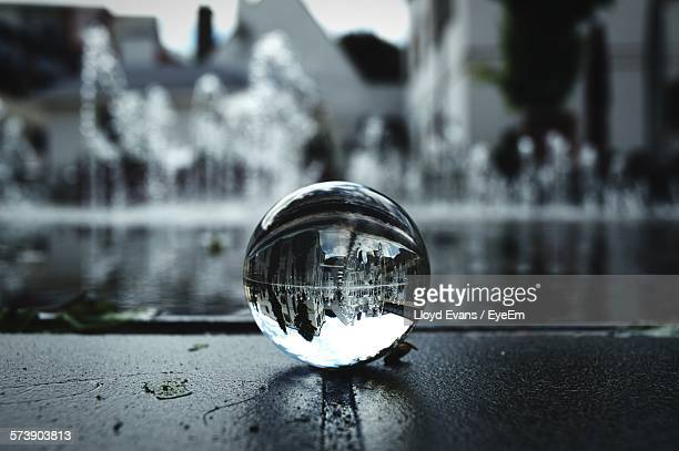 Reflection Of Cityscape On Crystal Ball