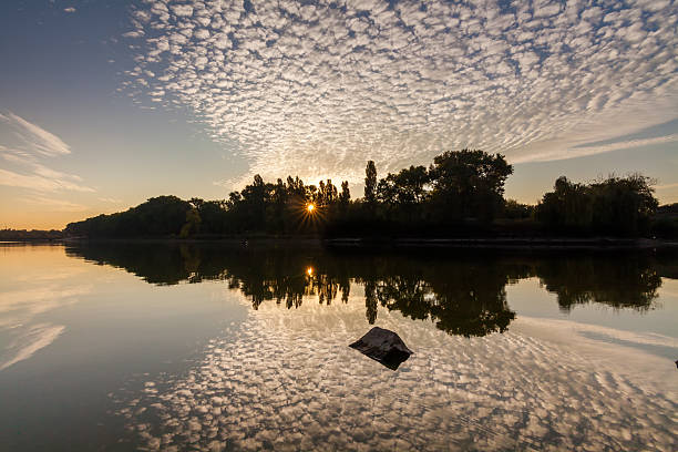 Reflection of clouds in a lake at dawn