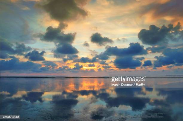 Reflection Of Clouds In Sky During Sunset