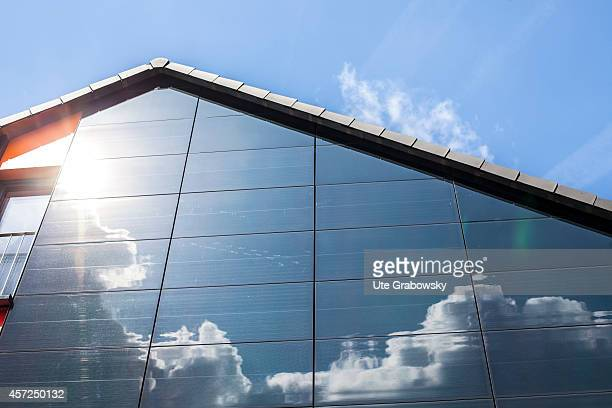 Reflection of clouds in solar panels on a VIVAWEST future house on August 21 in Bottrop Germany Vivawest is a large housing provider in North...