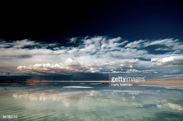 reflection of clouds in water, salar de uyuni, potosi department, bolivia - potosí potosí department stock pictures, royalty-free photos & images