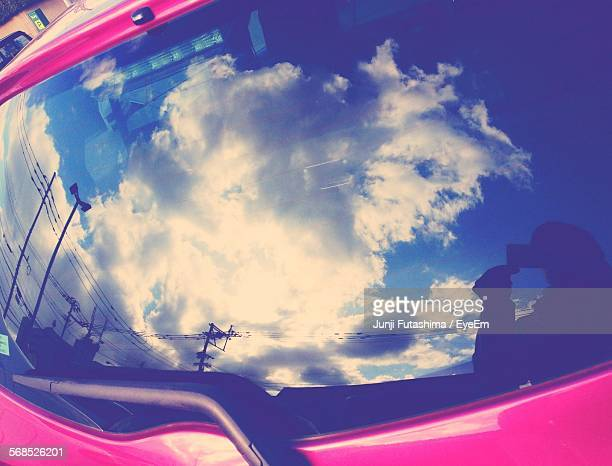 Reflection Of Clouds On Car Rear Windshield