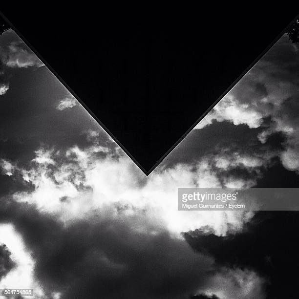 Reflection Of Clouds On Triangle Shaped Roof