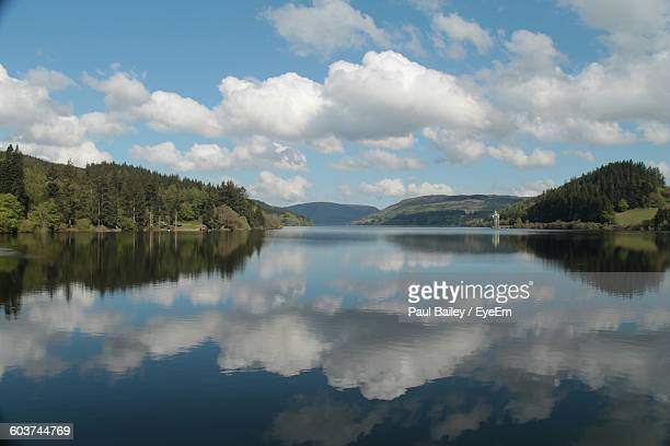 reflection of cloudy sky in sea - lake vyrnwy stock pictures, royalty-free photos & images