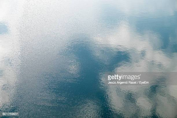 Reflection Of Cloudy Sky In Water