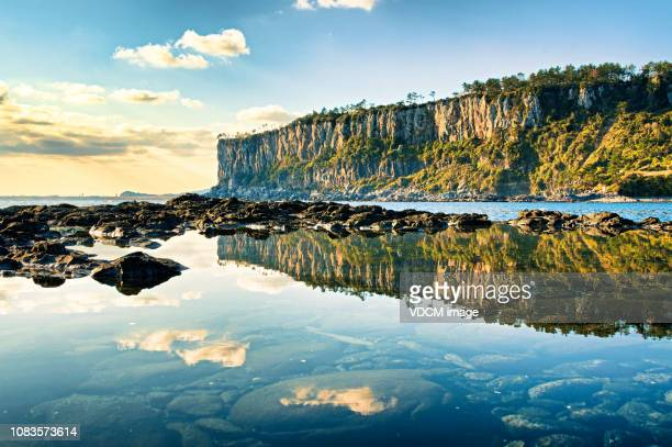 a reflection of coastal cliffs vd702 - south korea stock pictures, royalty-free photos & images
