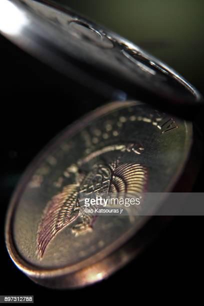 Reflection of coin on mirror surface. Conceptual money saving.