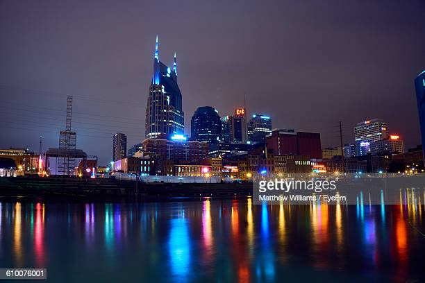 Reflection Of Colorful Lights Falling On River In City At Night