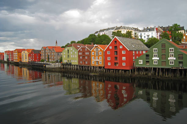 Reflection of colourful wooden houses in water