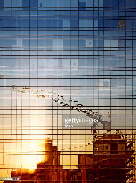 Reflection of construction work in a windowed building