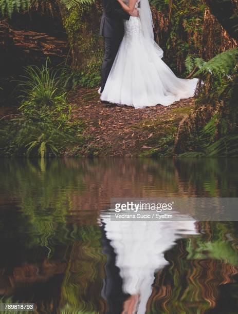 Reflection Of Couple In Lake