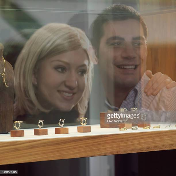 reflection of couple on shop window