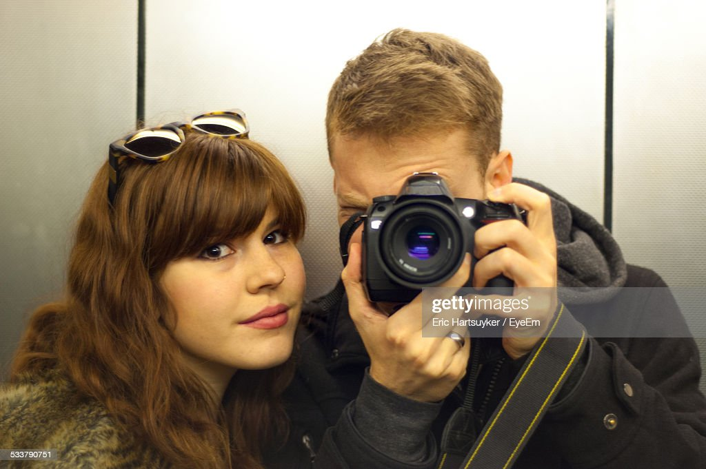 Reflection Of Couple Self Photographing Through Digital Camera : Foto stock