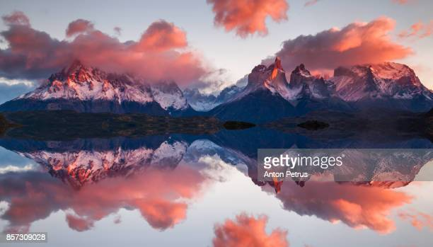 reflection of dawn in torres del paine, chile - reflection lake stock photos and pictures
