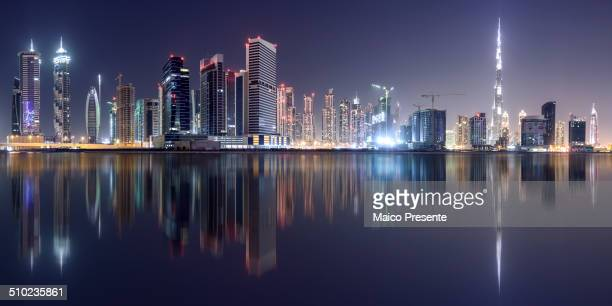 Reflection of Dubai Business Bay and view of Burj Khalifa.