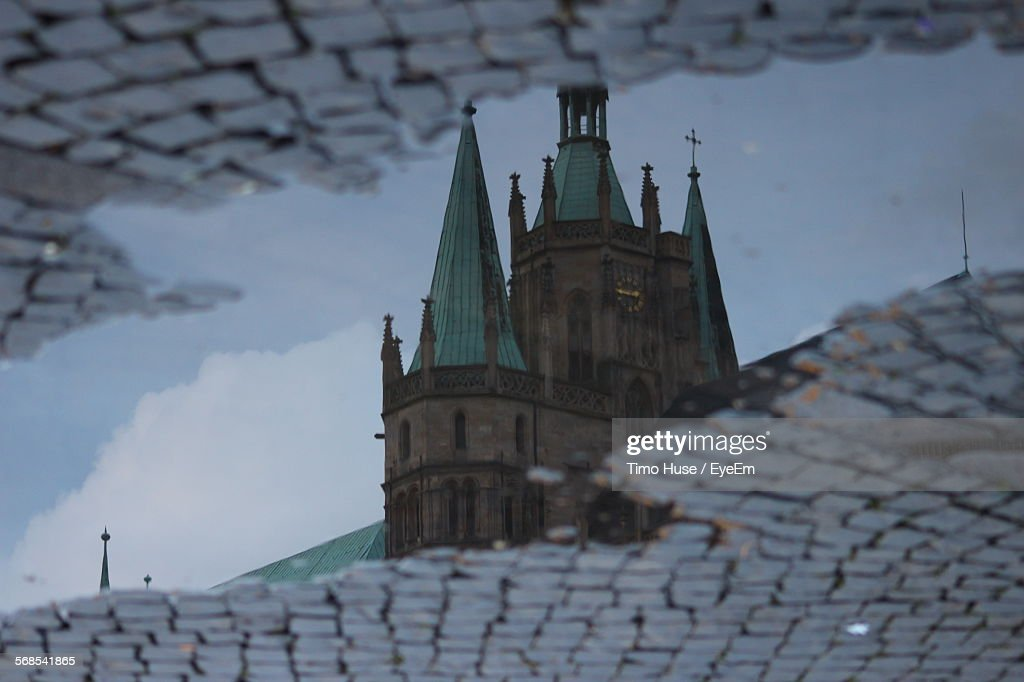 Reflection Of Erfurt Cathedral In Puddle : Stock Photo