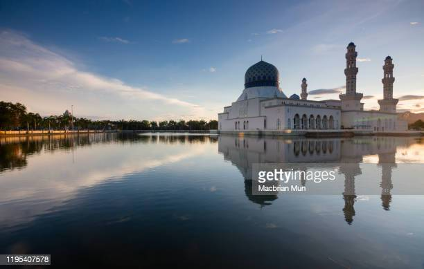 reflection of floating mosque with blue sky in kota kinabalu, sabah, malaysia - floating mosque stock pictures, royalty-free photos & images