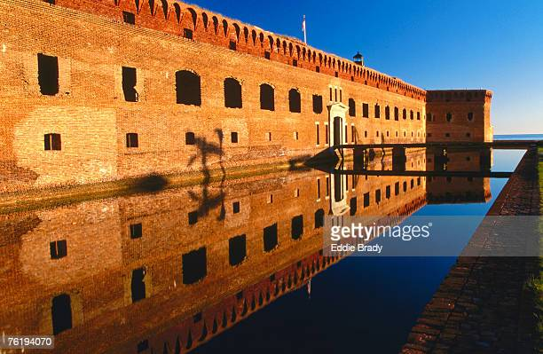 reflection of fort jefferson entrance, early morning, garden key, dry tortugas national park, florida, united states of america, north america - dry tortugas stock pictures, royalty-free photos & images