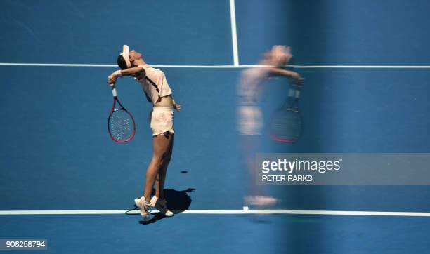 TOPSHOT A reflection of France's Caroline Garcia is seen as she plays Czech Republic's Marketa Vondrousova during their women's singles second round...