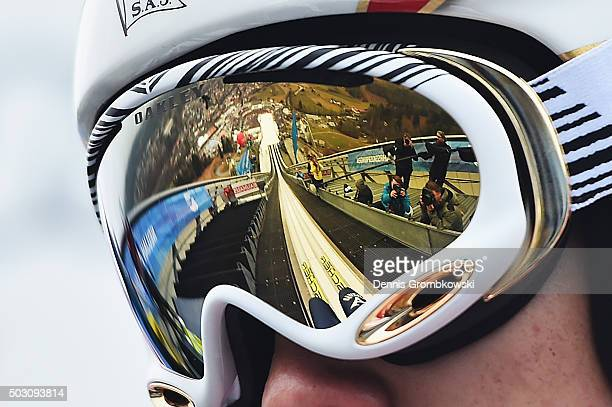Reflection of GarmischPartenkirchen ski jumping stadium is seen in the goggles of Taku Takeuchi of Japan jump on Day 2 of the 64th Four Hills...