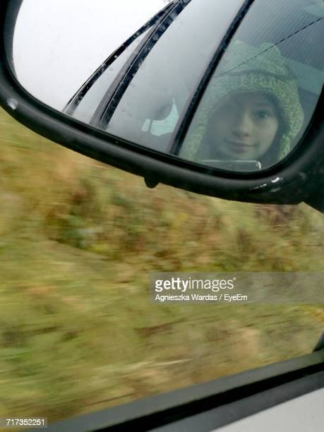 Reflection Of Girl In Side-View Mirror
