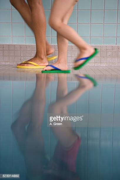 Reflection of Girls Walking at Indoor Pool