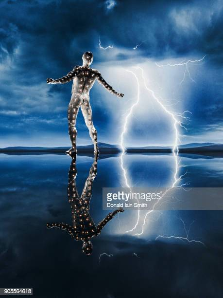 reflection of glowing man watching lightning - bolt stock photos and pictures