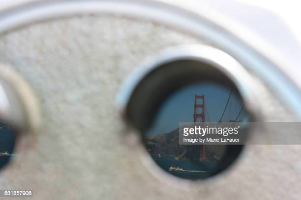 Reflection of Golden Gate Bridge in binoculars