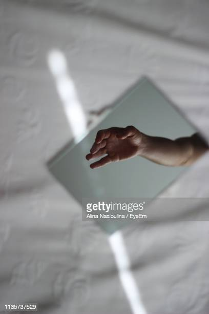 Reflection Of Hand In Mirror