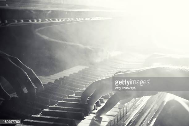 reflection of hand playing the piano - blues music stock pictures, royalty-free photos & images