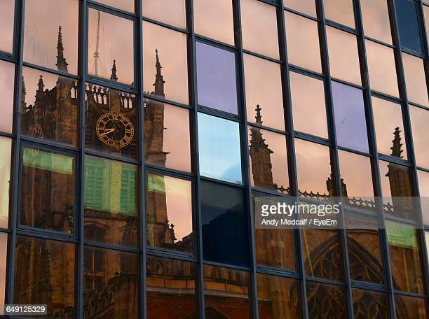 reflection of holy trinity church on glass window - kingston upon hull stock pictures, royalty-free photos & images