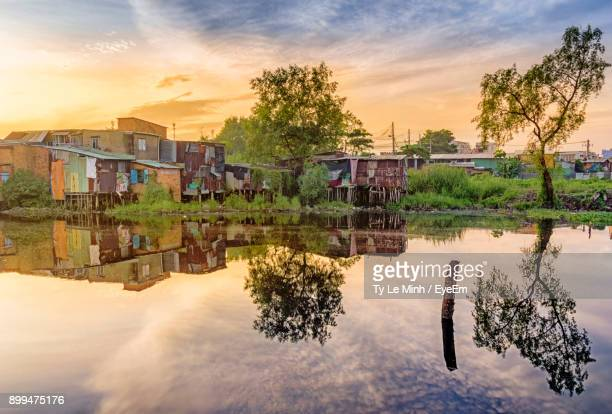 Reflection Of House On Lake Against Sky