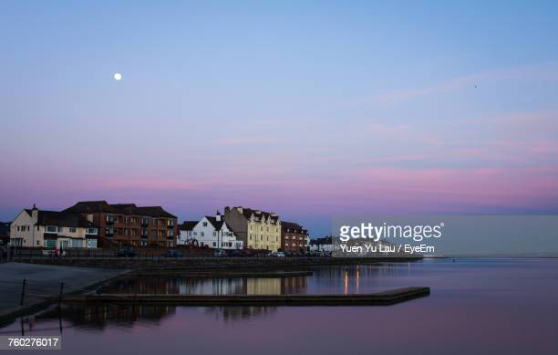 Reflection Of Houses In Sea At Night