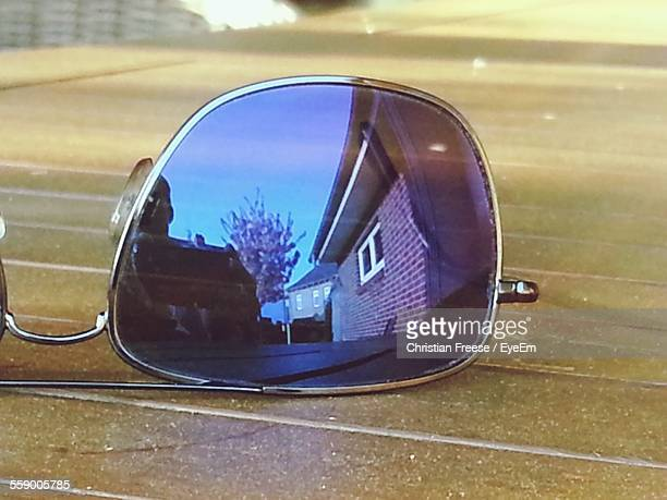 Reflection Of Houses In Sunglasses