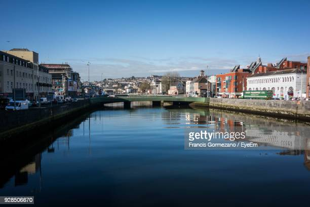 reflection of houses in town against blue sky - cork city stock pictures, royalty-free photos & images