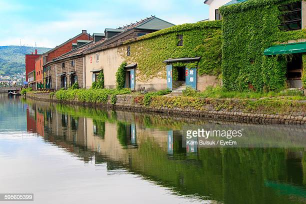 Reflection Of Houses On River