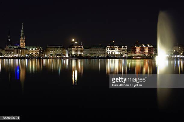 Reflection Of Illuminated Buildings In Calm Binnenalster During Night