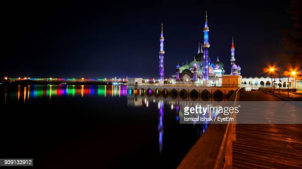 Reflection Of Illuminated Mosque In Calm River