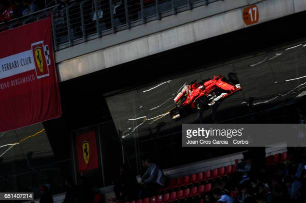 A reflection of Kimi Räikkönen of Scuderia Ferrari driving his car during the Formula One Winter tests on May 9 2017 in Barcelona Spain