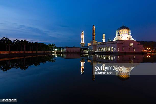 Reflection of Kota Kinabalu city mosque at dawn