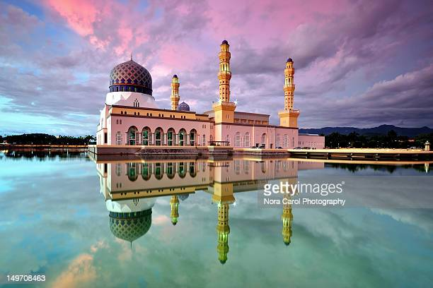 reflection of kota kinabalu city mosque at sunset - kota kinabalu stock pictures, royalty-free photos & images