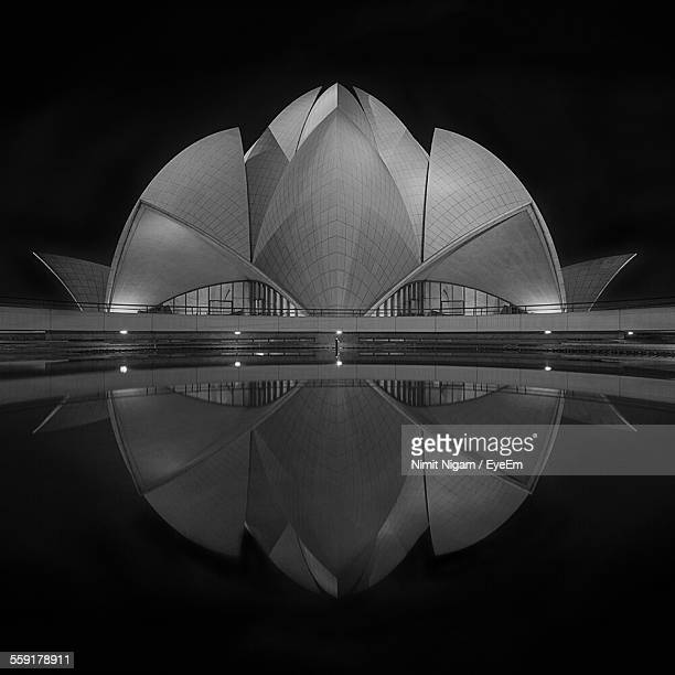 reflection of lotus temple in water - architectural feature stock pictures, royalty-free photos & images
