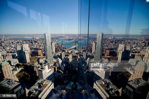 A reflection of lower manhattan is reflected in the window of 4 World Trade Center after a dedication ceremony in New York US on Monday Nov 4 2013 4...