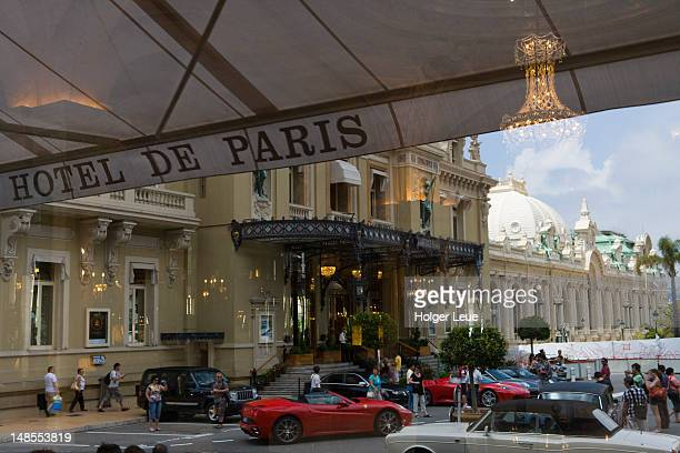 reflection of luxury automobiles and monte carlo casino in window of hotel de paris. - monte carlo stock pictures, royalty-free photos & images
