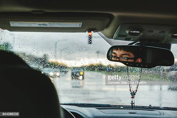 reflection of man on rear-view mirror - pendant stock pictures, royalty-free photos & images