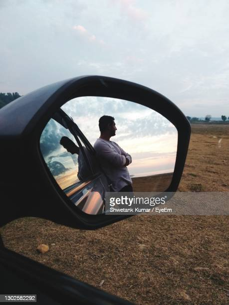 reflection of man on side-view mirror - chandigarh stock pictures, royalty-free photos & images