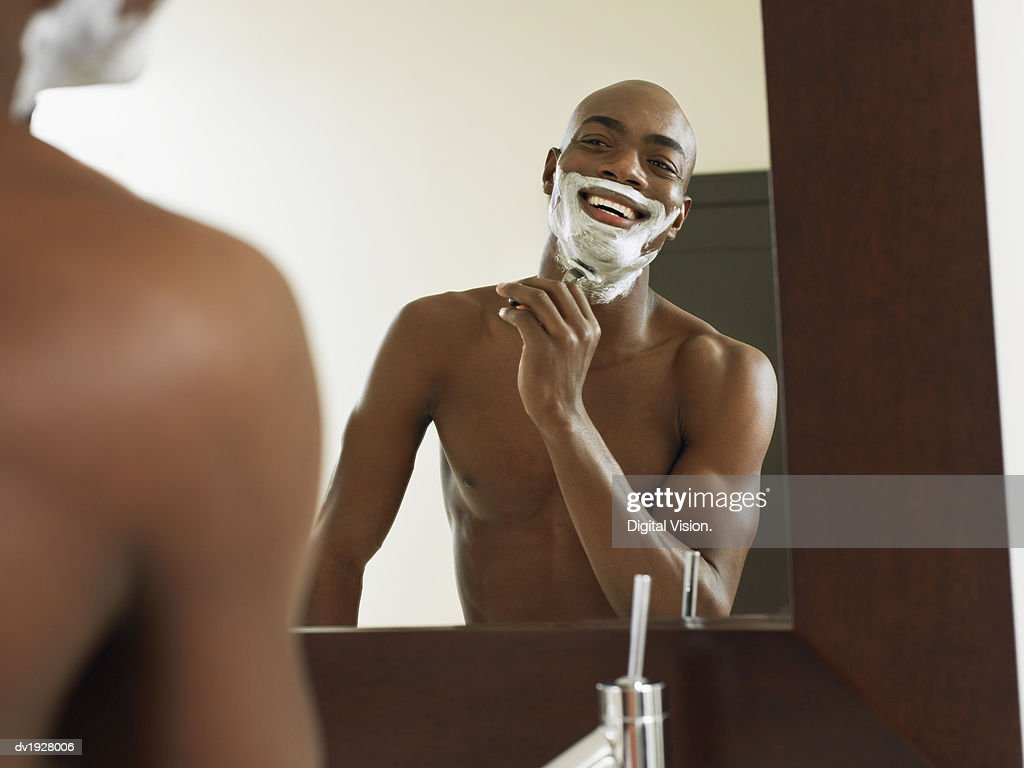 Reflection of Man Shaving in a Bathroom Mirror : Stock Photo