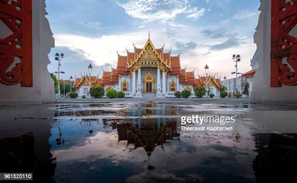 reflection of marble temple (wat benchamabophit), bangkok, thailand - wat benchamabophit stock photos and pictures